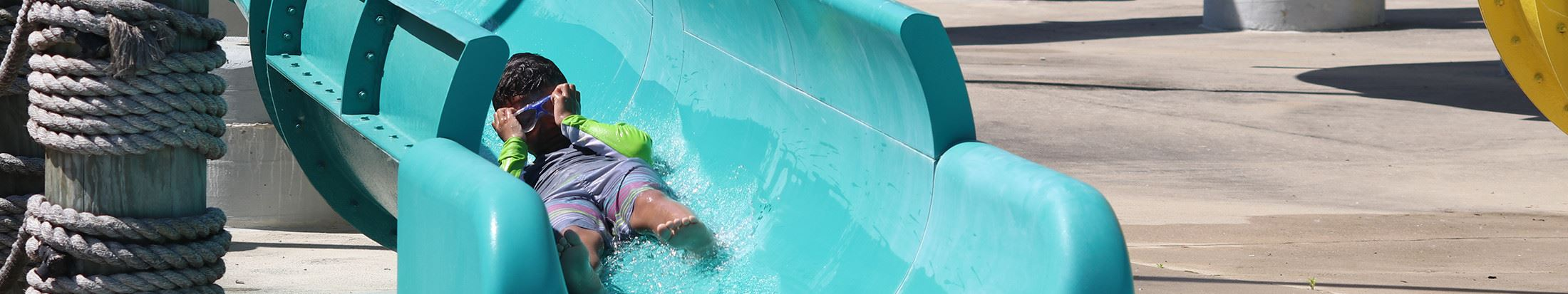 Child enjoying water slide at Splash Park